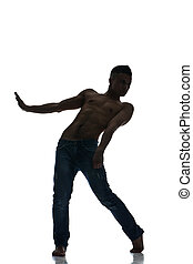 Silhouette of a young man dancer isolated