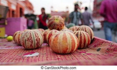 Melons on sale in street - Melons being sailed in street