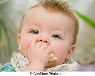 Portrait of a cute young baby boy eating - Portrait of a...