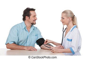 Attractive nurse measure the pressure of adult male patient.  Sitting over white background