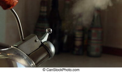 Spout of whistling simmering kettle