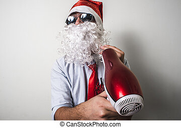 funny santa claus babbo natale with hairdryer on white...