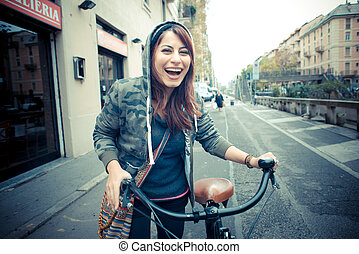beautiful red head woman on bike - beautiful red head...