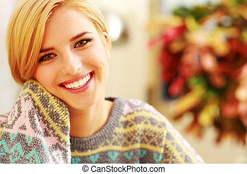 Closeup portrait of a young smiling woman at home