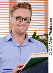 Interesting book Young cheerful men in glasses reading a...