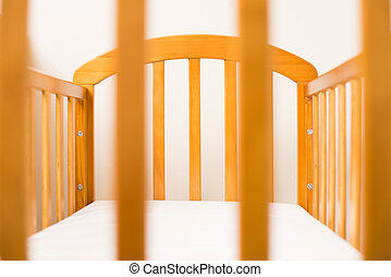 Wooden Cot Frame for a new baby - Close up of a Wooden Cot...