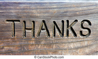 Thanks words in carved in wood