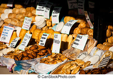 Traditional polish smoked cheese oscypek on outdoor market...