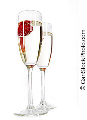 Pair of champagne flutes over white background
