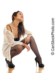 sitting girl - Young beautiful girl in a white shirt and...