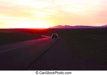Driving in the desert at sunset in Morocco Africa
