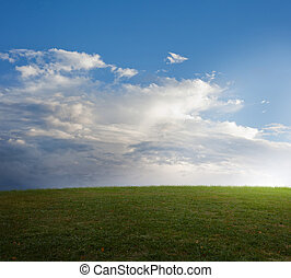 Grassy field. - Green grassy field with beautiful clouds and...