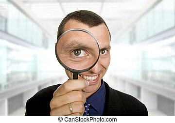 loupe - business man with a loupe at the office