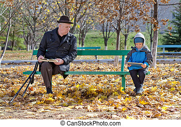 Grandfather watching over his young grandson - Elderly...
