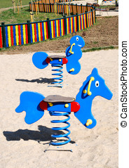 Rocking horse - Empty colorful rocking horse and worm on a...