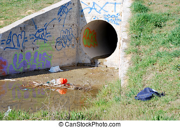 Urban culvert - Dirty urban culvert. Drainage pipe. Ecology...