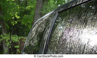 strong rain car window - Strong rain water drops fall and...