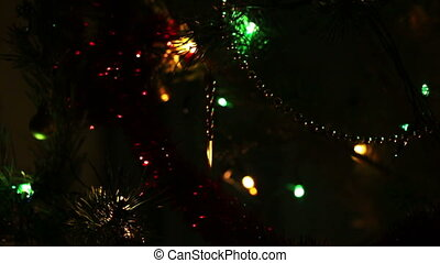 decorated christmas tree with flashing garlands - changing focus