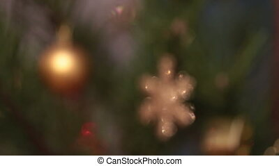 defocused decorated christmas tree with flashing garlands