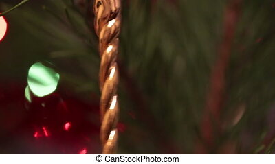 decorated christmas tree with flashing garlands closeup