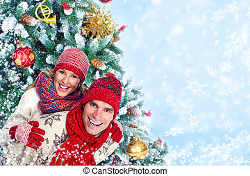 Happy christmas couple in winter clothing - Happy couple in...