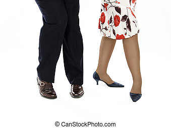 Pair in salsa position - Lady in colorful skirt with a...
