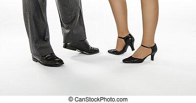 Elegant feet in ballroom - Male and female feet in crocodile...