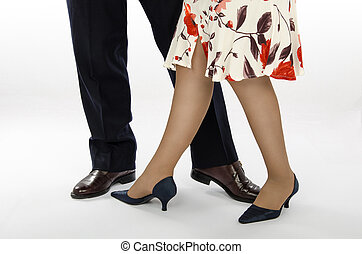 Elegant partners are dancing - Lady in colorful skirt with a...