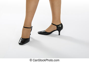 Lady feet in elegant shoes - Female feet in crocodile skin...