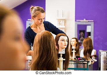 Pretty female hairdresser/haidressing apprentice/student