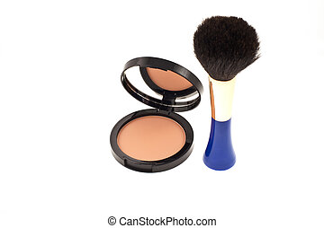 face powder with mirror and a brush
