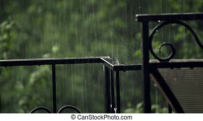 Hammered fence under the rain