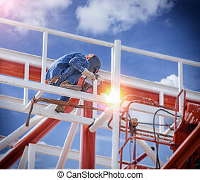 Workers welding steel structures with lifter and hight area