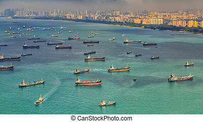 Singapore - Landscape from bird view of Cargo ships entering...