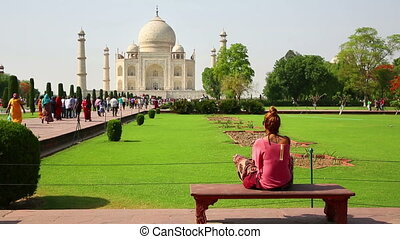 Caucasian woman at Taj Mahal - Caucasian woman sitting on...