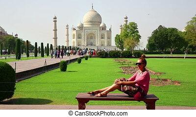 Caucasian woman posing, Taj Mahal