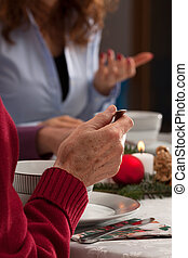 Conversation during christmas dinner - Family eating and...