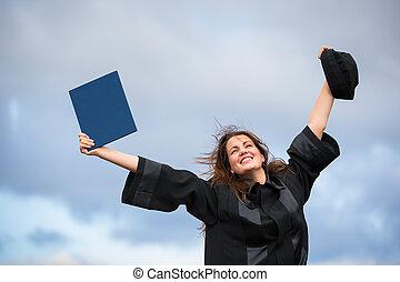 Pretty, young woman celebrating