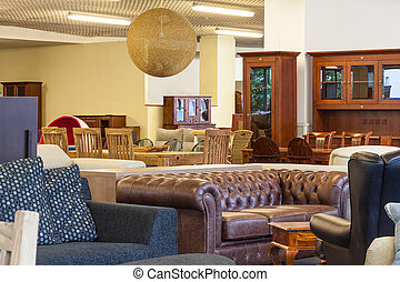 Shop with furniture - A shop with various pieces of...