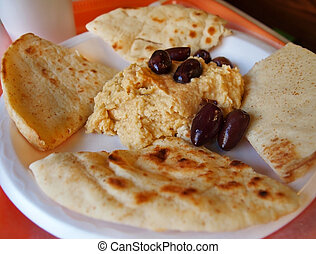 Hummus Platter With Kalamata Olives - A carryout tray with a...