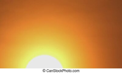 Sun in haze - the morning sun with haze and clouds during...