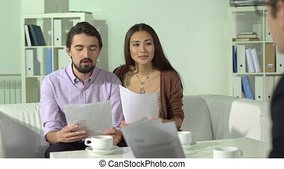 Personal adviser - Married couple consulting with their...