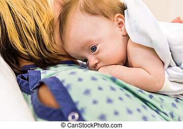 Babygirl Lying On Mother In Hospital - Closeup of adorable...
