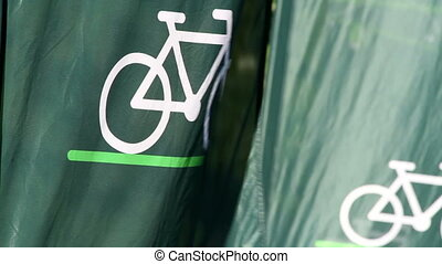 Bicycle Flag Waving Strongly - A green background banner...