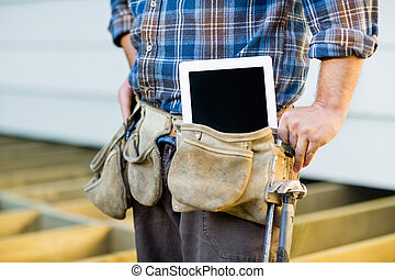 Construction Worker With Tablet Computer In Toolbelt -...