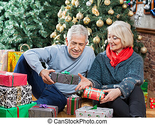 Couple With Presents Sitting In Christmas Store