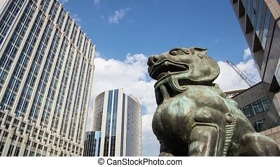 Financial District in Beijing - The bronze lion sculpture in...