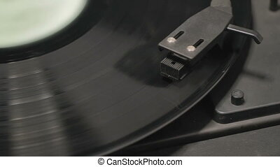 Detail of vintage record player with spinning vinyl. Shallow...