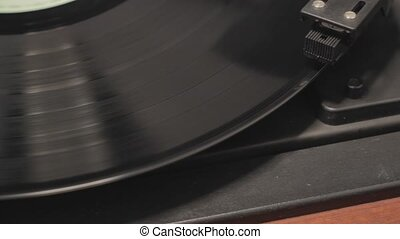 Detail of vintage record player with spinning vinyl Shallow...