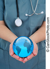 World Health - Female Doctor Holding A World Globe In Her...